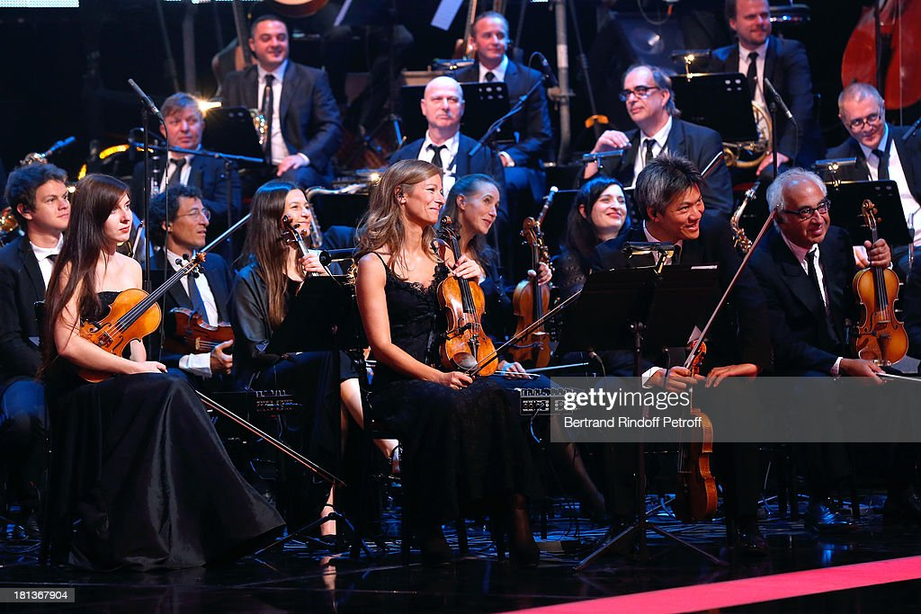 Violonist Anne Gravoin (C blond hair) and orchestra perform at 'Le Grand Show' by Laurent Gerra : Rehearsal at La Plaine Saint Denis on September 20, 2013 in Paris, France.