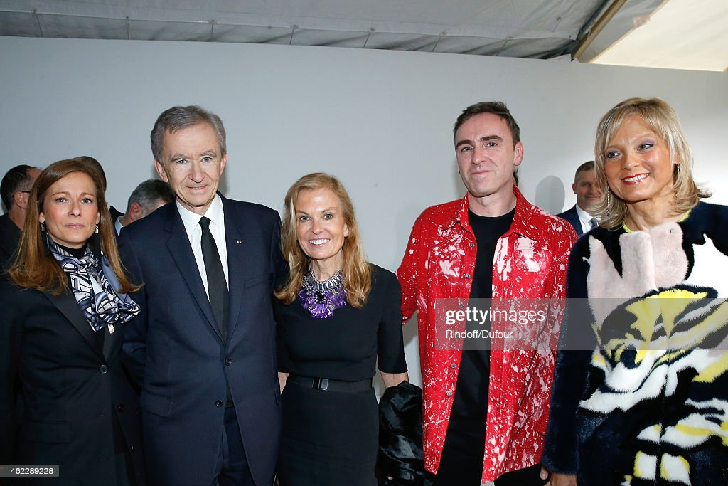 Violonist Anne Gravoin, Owner of LVMH Luxury Group Bernard Arnault, Ambassador of USA in France, Jane D. Hartley, Fashion Designer Raf Simons and Helene Arnault pose backstage after Christian Dior show as part of Paris Fashion Week Haute-Couture Spring/Summer 2015 on January 26, 2015 in Paris, France.