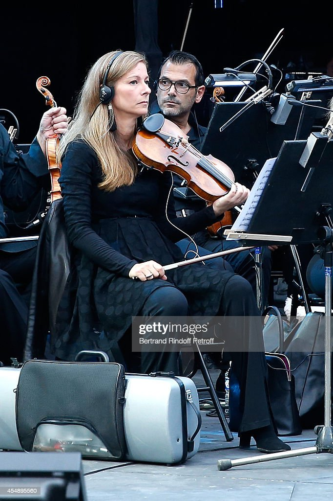 Violonist Anne Gravoin performs during rehearsals of the 'Claude Lelouch en Musique ! Held at the Invalides in Paris on September 6, 2014 in Paris, France.