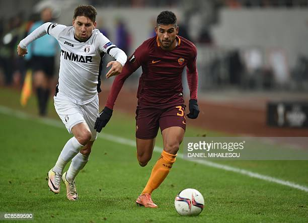 Viorel Nicoara of Astra Giurgiu vies for the ball with Emerson Palmieri of AS Roma during the UEFA Europa League Group E football match between FC...