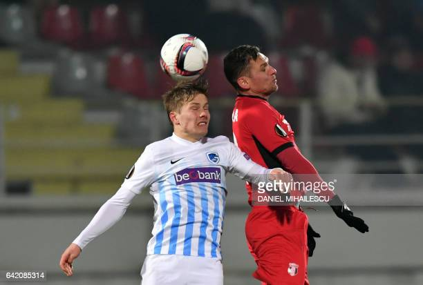 Viorel Nicoara of Astra Giurgiu vies for the ball with Jere Uronen of KRC Genk during the UEFA Europa League round of 32 firstleg football match...
