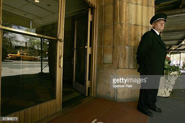 Viorel Pasku a doorman with a building on Central Park West works in front of his building April 19 2006 in New York City Thousands of New York City...
