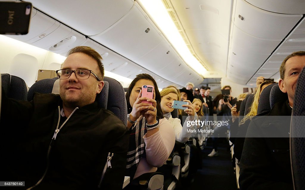 VIPs and competition winners take photos and film footage as Jessie J performs a summer party themed gig on board a British Airways 777-300 on June 30, 2016 in Sydney, Australia.The singer-songwriter played an acoustic set for VIPs and competition winners to celebrate the arrival of summer in the UK.