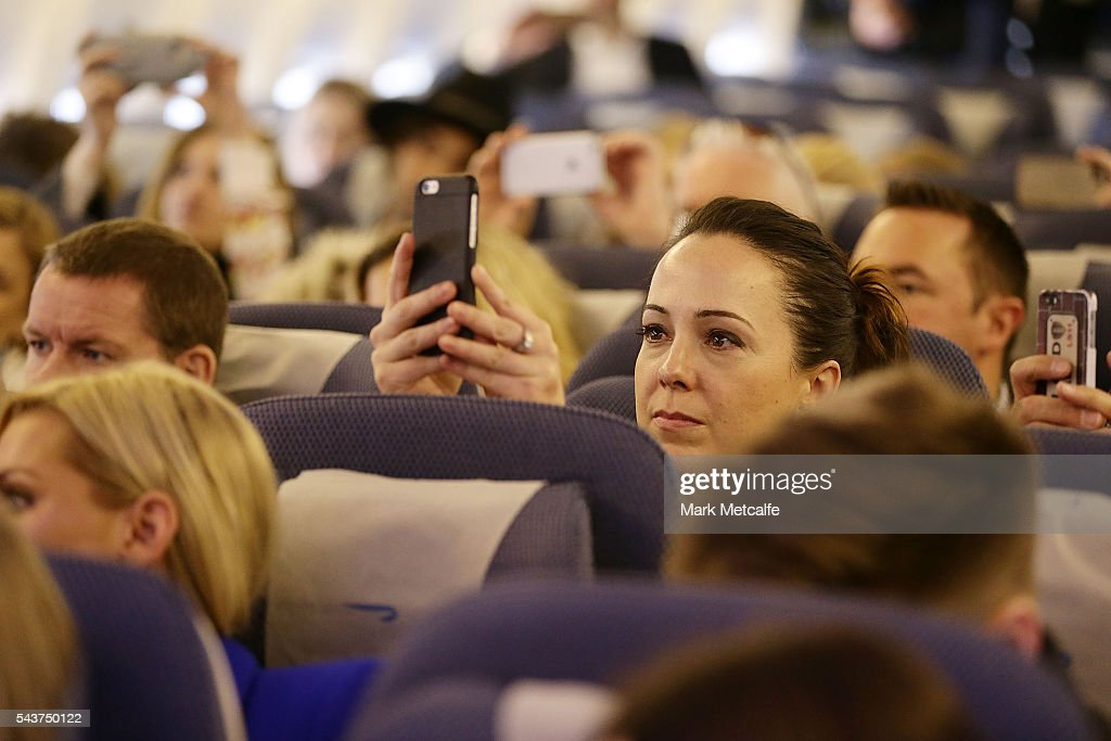 VIPs and competition winners take photos as Jessie J performs a summer party themed gig on board a British Airways 777-300 on June 30, 2016 in Sydney, Australia.The singer-songwriter played an acoustic set for VIPs and competition winners to celebrate the arrival of summer in the UK.