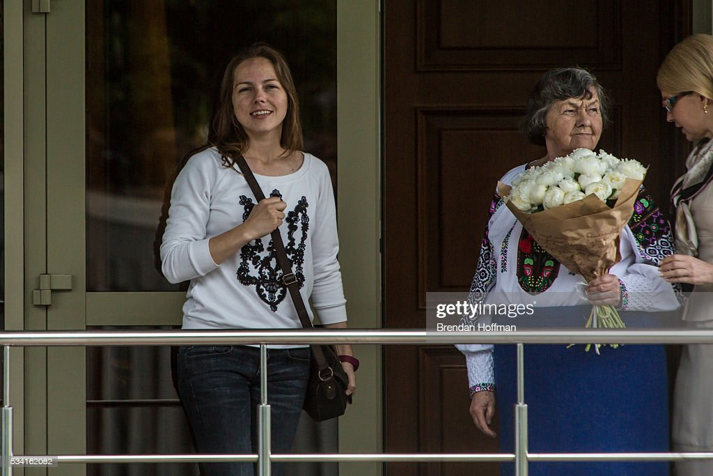 Vira Savchenko (L), Maria Savchenko (C), sister and mother respectively of Ukrainian military pilot Nadiya Savchenko, are joined by <a gi-track='captionPersonalityLinkClicked' href=/galleries/search?phrase=Yulia+Tymoshenko&family=editorial&specificpeople=546280 ng-click='$event.stopPropagation()'>Yulia Tymoshenko</a> (R), a Ukrainian member of parliament, to greet Nadiya Savchenko upon her arrival at Kyiv Boryspil Airport on May 25, 2016 in Boryspil, Ukraine. Savchenko was captured while fighting Russia-backed rebels in eastern Ukraine and put on trial in Russia on charges that she was complicit in the deaths of two Russian journalists. She was elected to the Ukrainian parliament under Tymoshenko's Fatherland party while being held in Russia, and in March she was convicted of murder and sentenced to 22 years in prison, but was reportedly swapped for two Russian fighters captured by Ukrainian forces.