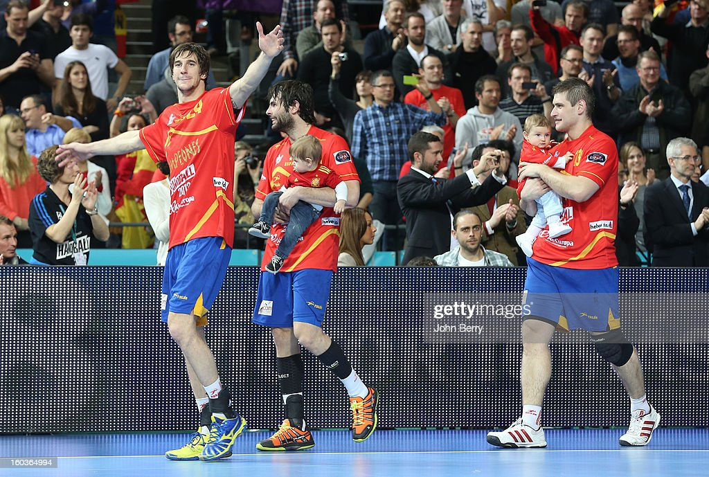 Viran Morros, Antonio Garc'a, Julen Aguinagalde of Spain celebrate their victory and their gold medal after the Men's Handball World Championship 2013 final match between Spain and Denmark at Palau Sant Jordi on January 27, 2013 in Barcelona, Spain.