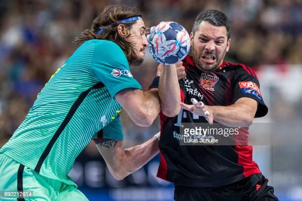 Viran Morros of Barcelona attacks Jose Maria Rodriguez of Veszprem during the VELUX EHF FINAL4 3rd place match between Telekom Veszprem and FC...