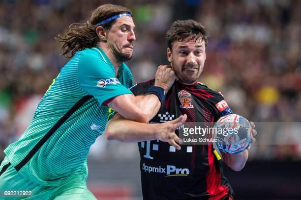 Viran Morros of Barcelona attacks Mate Lekai of Veszprem during the VELUX EHF FINAL4 3rd place match between Telekom Veszprem and FC Barcelona Lassa...