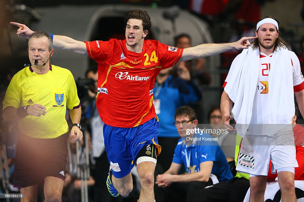 Viran Morros of Spain celebrates a goal and Mikkel Hansen of Denmark looks dejected during the Men's Handball World Championship 2013 final match between Spain and Denmark at Palau Sant Jordi on January 27, 2013 in Barcelona, Spain.