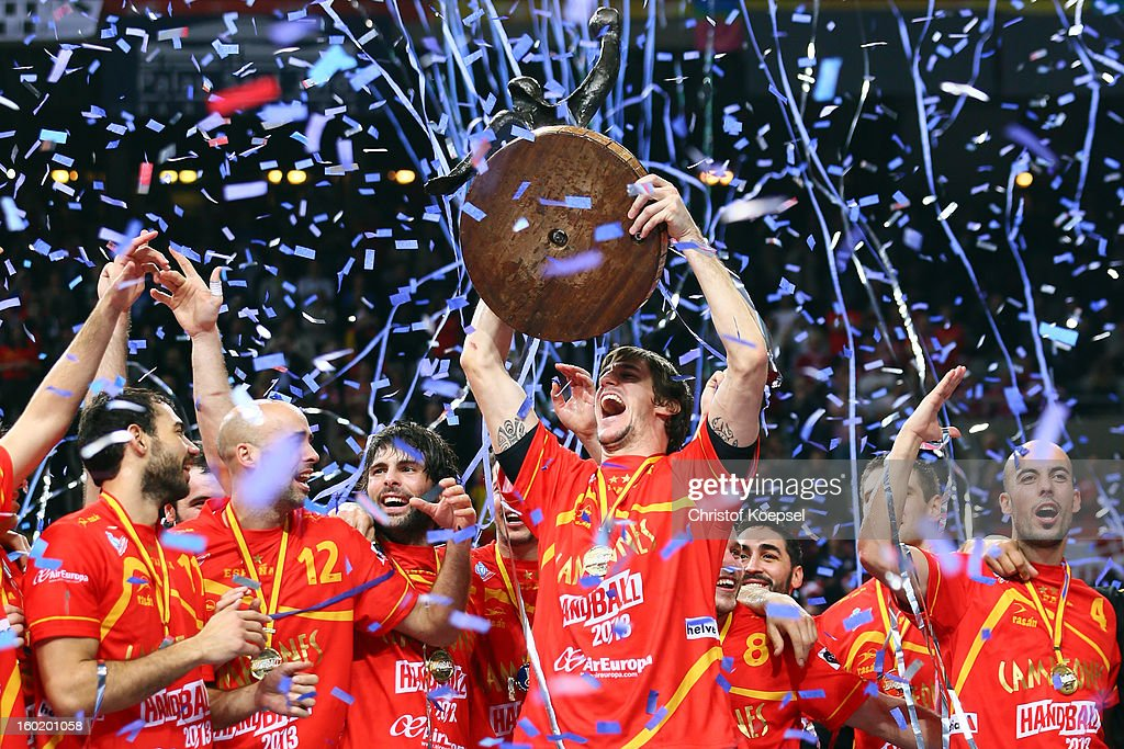 Viran Morros of Spain lifts the trophy on the podium after winning the Men's Handball World Championship 2013 final match between Spain and Denmark at Palau Sant Jordi on January 27, 2013 in Barcelona, Spain.