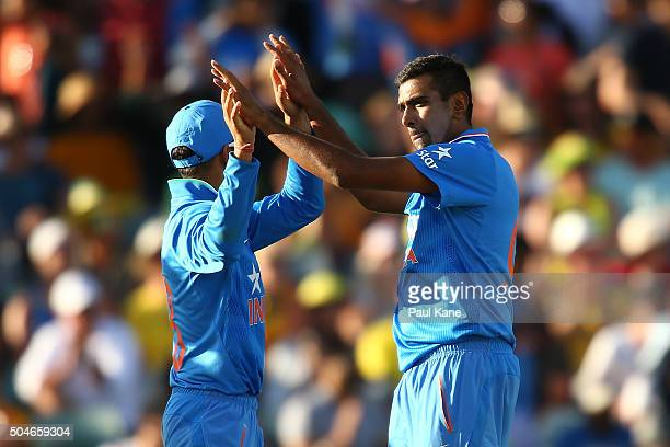 Virat Kholi and Ravi Ashwin of India celebrate the dismissal of George Bailey of Australia during the Victoria Bitter One Day International Series...