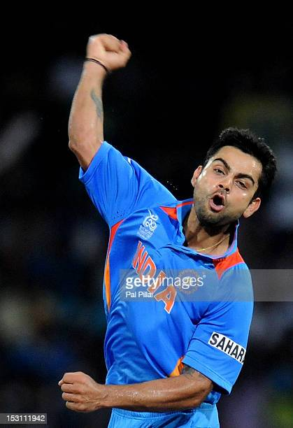 Virat Kholi of India celebrates the wicket of Mohammad Afeez of Pakistan during the ICC T20 World Cup Super Eight group 2 cricket match between...