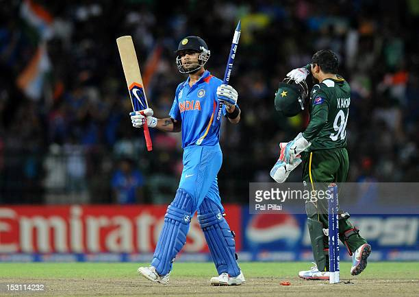Virat Kholi of India celebrates victory in the ICC T20 World Cup Super Eight group 2 cricket match between Pakistan and India held at R Premadasa...