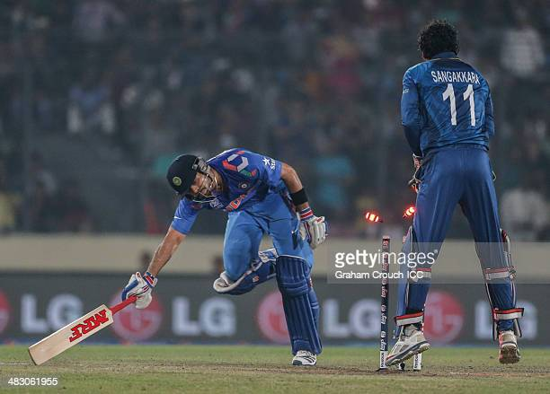 Virat Kholi of India is run out of the last ball of the innings with Kumar Sangakkara of Sri Lanka appealing during the India v Sri Lanka Final ICC...