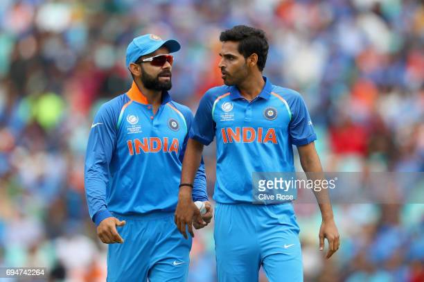 Virat Kohli and Bhuvneshwar Kumar of India chat in the field during the ICC Champions trophy cricket match between India and South Africa at The Oval...