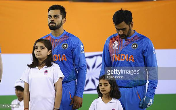Virat Kohli and MS Dhoni Captain of India sing the anthem during the ICC WT20 India Group 2 match between India and Australia at IS Bindra Stadium on...