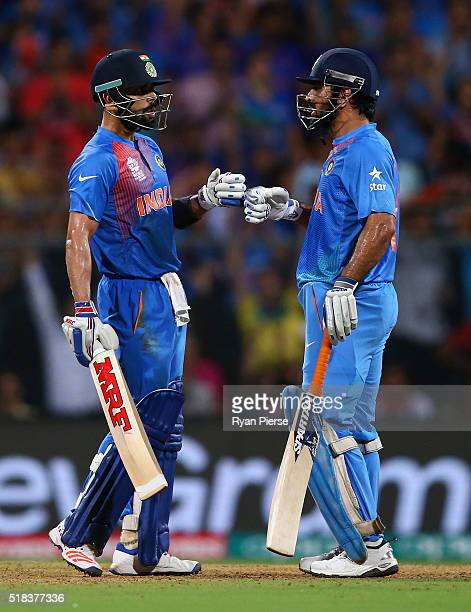Virat Kohli and MS Dhoni Captain of India talk during the ICC World Twenty20 India 2016 Semi Final match between West Indies and India at Wankhede...