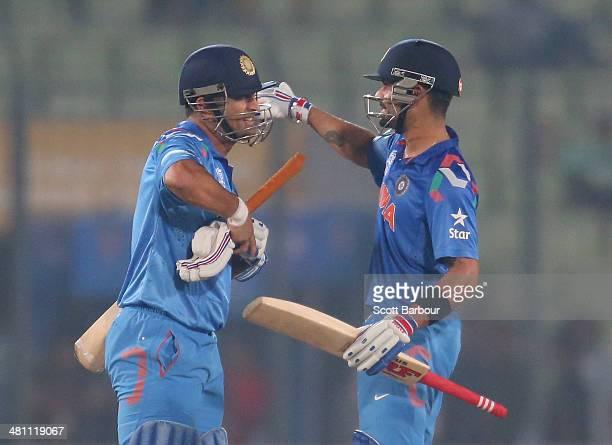 Virat Kohli and MS Dhoni of India embrace after winning the ICC World Twenty20 Bangladesh 2014 match between Bangladesh and India at ShereBangla...