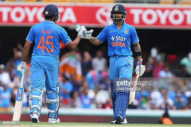 Virat Kohli and Rohit Sharma celebrate a boundary during game two of the Victoria Bitter One Day International Series between Australia and India at...