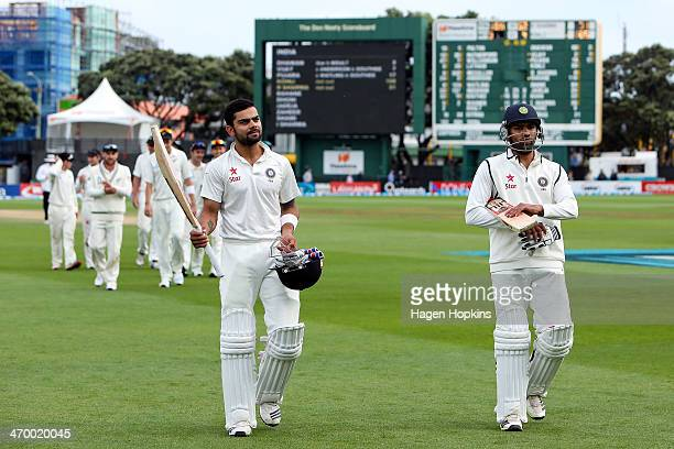 Virat Kohli and Rohit Sharma of India leave the field at the end of the match during day five of the 2nd Test match between New Zealand and India on...