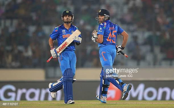 Virat Kohli and Rohit Sharma of India look on during the ICC World Twenty20 Bangladesh 2014 match between Bangladesh and India at ShereBangla Mirpur...
