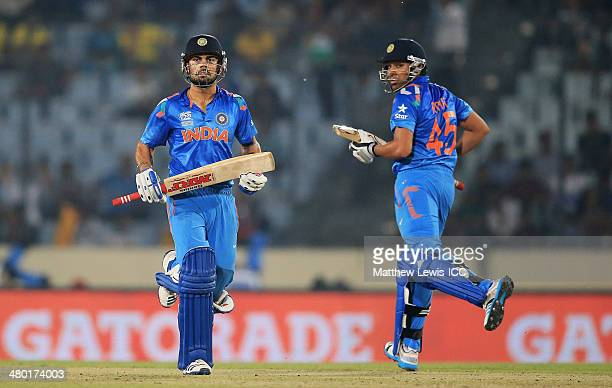 Virat Kohli and Rohit Sharma of India run between the wickets during the ICC World Twenty20 Bangladesh 2014 match between West Indies and India at...