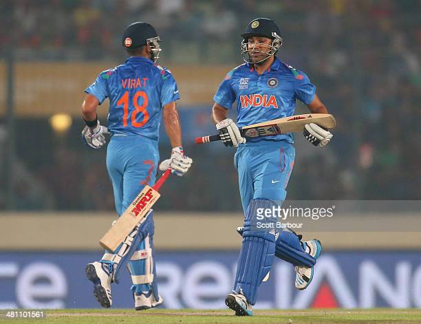 Virat Kohli and Rohit Sharma of India run between the wickets during the ICC World Twenty20 Bangladesh 2014 match between Bangladesh and India at...