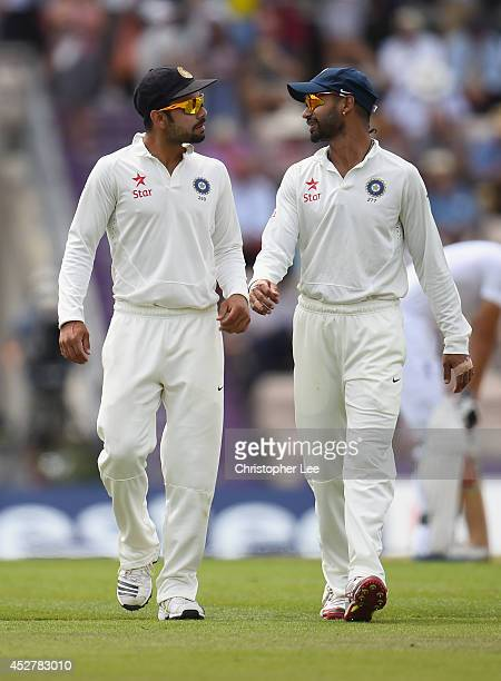 Virat Kohli and Shikhar Dhawan of India talk as they walk out onto the pitch for the second session during Day 1 of the 3rd Investec Test match...