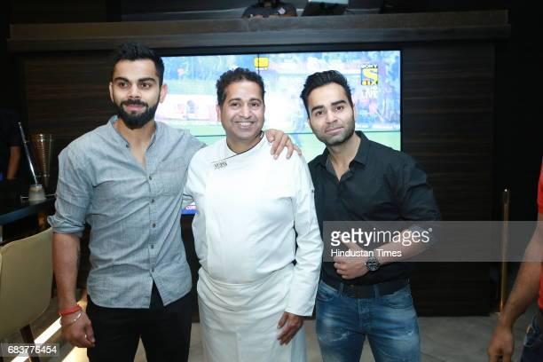 Virat Kohli and Vikas Kohli with Chef Michael Swamy during special dinner for Royal Challengers Bangalore teammates by Virat Kohli at his new...