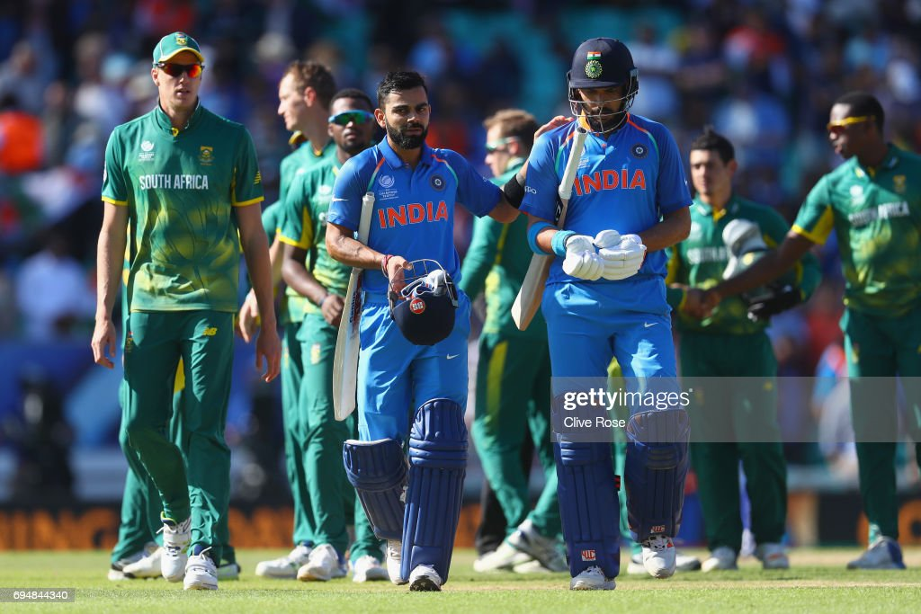 Virat Kohli and Yuvraj Singh of India in leave the field after India win the ICC Champions trophy cricket match between India and South Africa at The Oval in London on June 11, 2017