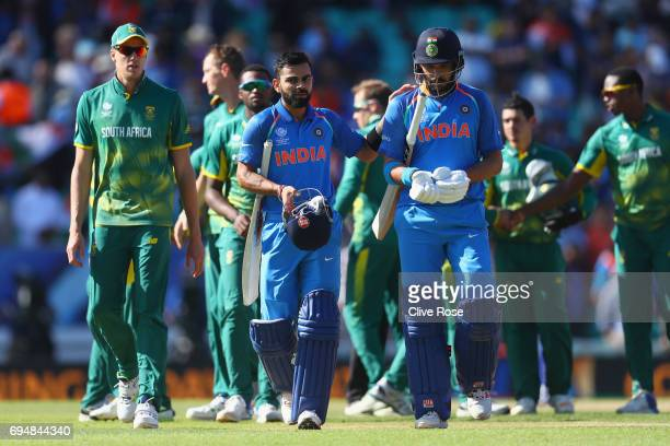 Virat Kohli and Yuvraj Singh of India in leave the field after India win the ICC Champions trophy cricket match between India and South Africa at The...