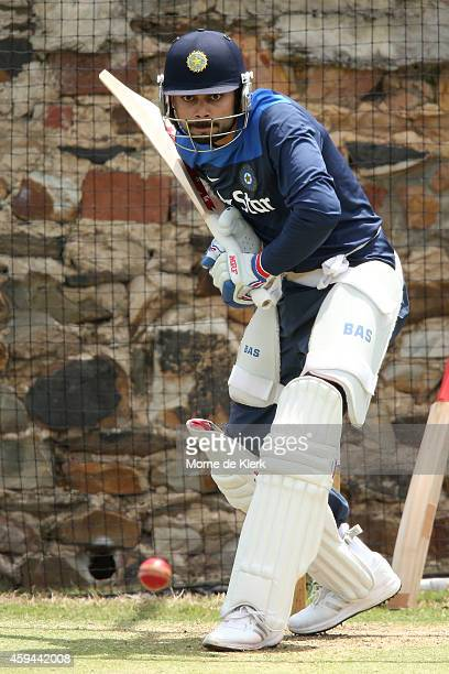 Virat Kohli bats in the nets during a training session for the Indian cricket team at Gliderol Stadium on November 23 2014 in Adelaide Australia