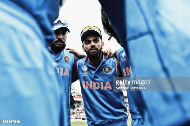 Virat Kohli captain of India talks to his players ahead of the ICC Champions Trophy Semi Final match between Bangladesh and India at Edgbaston on...