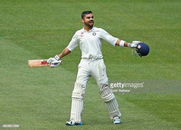 Virat Kohli celebrates after reaching his century during day three of the Third Test match between Australia and India at Melbourne Cricket Ground on...