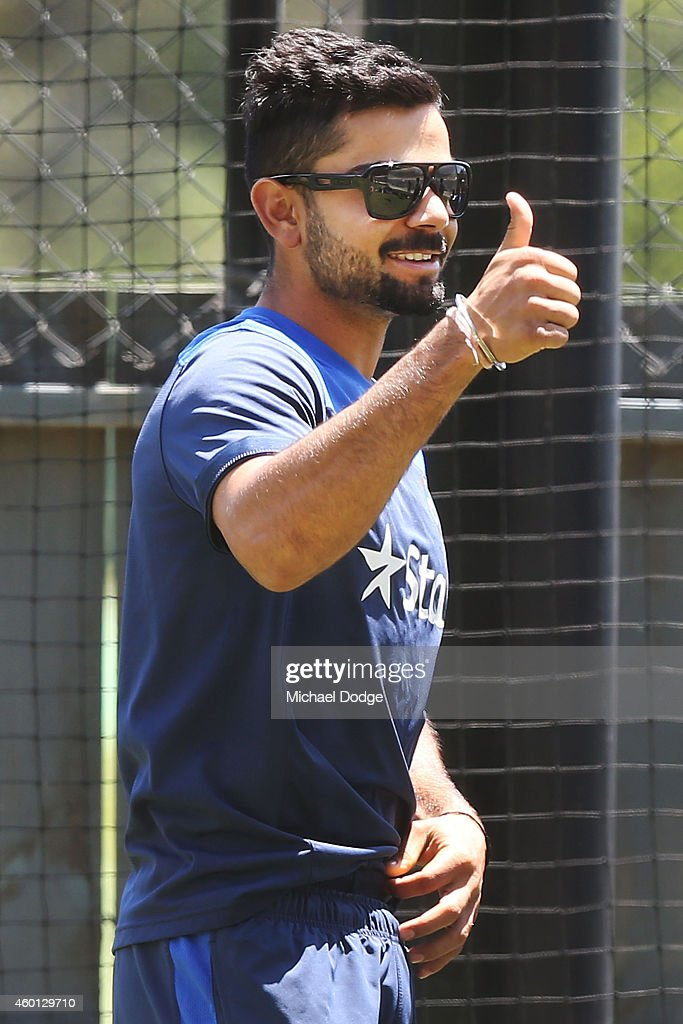 <a gi-track='captionPersonalityLinkClicked' href=/galleries/search?phrase=Virat+Kohli&family=editorial&specificpeople=4880246 ng-click='$event.stopPropagation()'>Virat Kohli</a> gestures in the nets during an India Training Session at Adelaide Oval on December 8, 2014 in Adelaide, Australia. Kohi was made captain after the withdrawal of MS Dhoni.