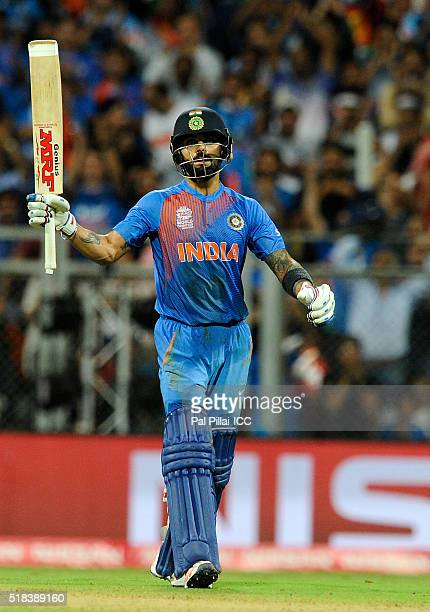 Virat Kohli of India acknowledges the crowd after scoring a half century during ICC World Twenty20 India 2016 Semi Final match between India and West...