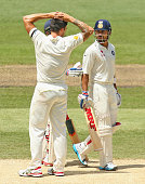 Virat Kohli of India and bowler Mitchell Johnson of Australia exchange words at the end of an over after Kohli was struck by a throw at the stumps...
