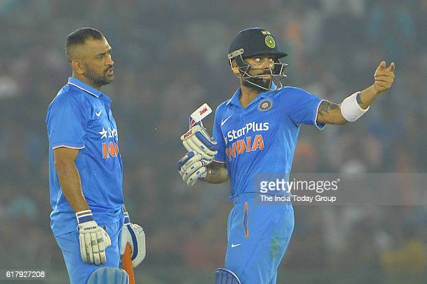 Virat Kohli of India and Mahendra Singh Dhoni captain of India during the third oneday international cricket match against New Zealand in Mohali