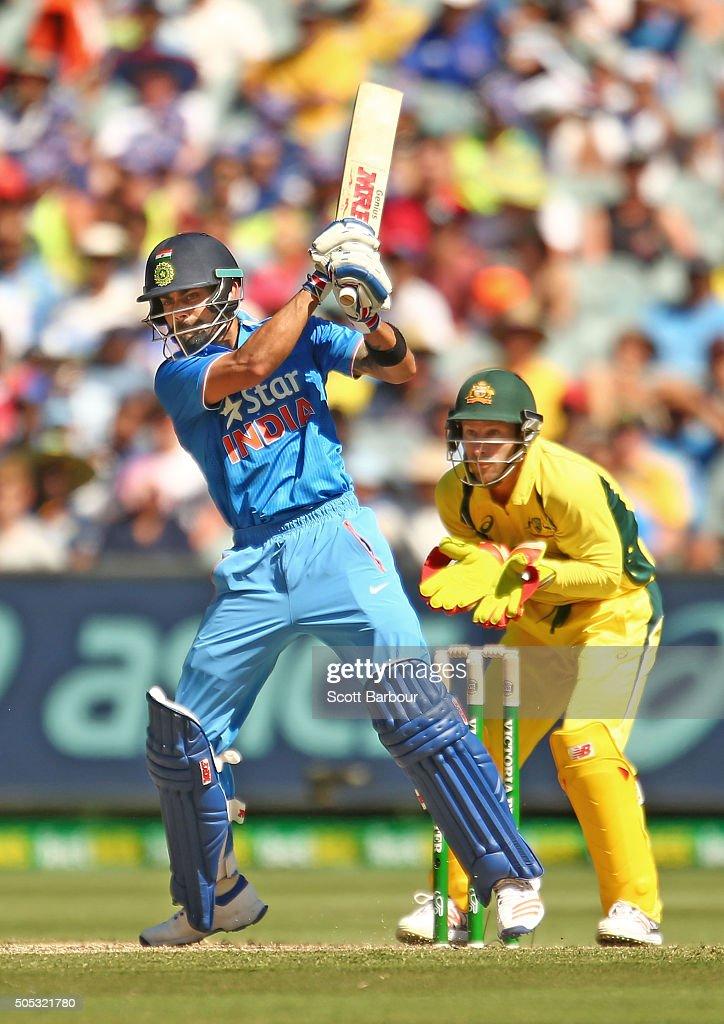 Virat Kohli of India bats as wicketkeeper Matthew Wade of Australia looks on during game three of the One Day International Series between Australia...