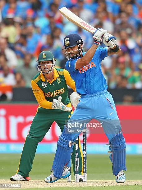 Virat Kohli of India bats as wicketkeeper Quinton de Kock of South Africa looks on during the 2015 ICC Cricket World Cup match between South Africa...
