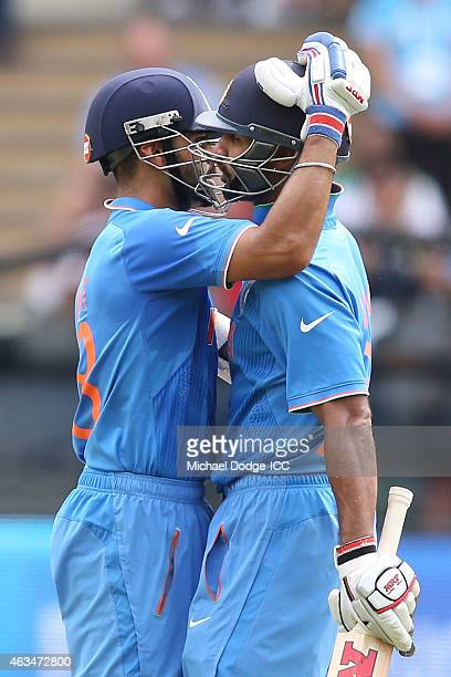 Virat Kohli of India bats hugs Shikhar Dhawan who made a half century during the 2015 ICC Cricket World Cup match between India and Pakistan at...