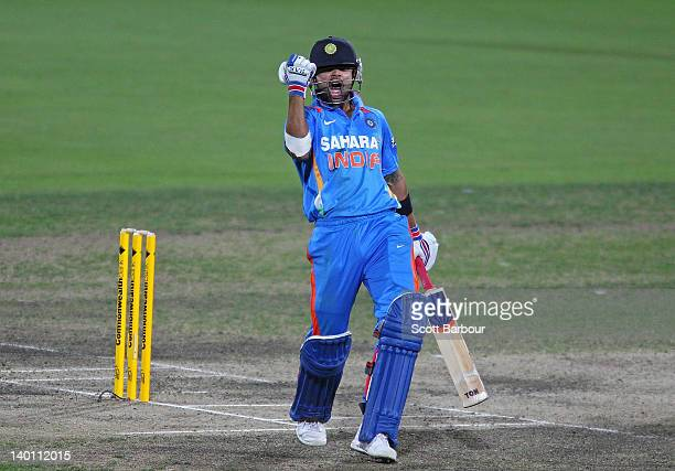 Virat Kohli of India celebrates after hitting the winning runs during the One Day International match between India and Sri Lanka at Bellerive Oval...