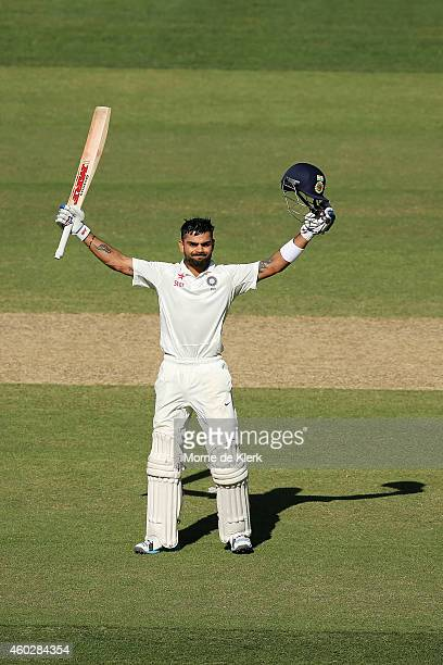 Virat Kohli of India celebrates after reaching 100 runs during day three of the First Test match between Australia and India at Adelaide Oval on...