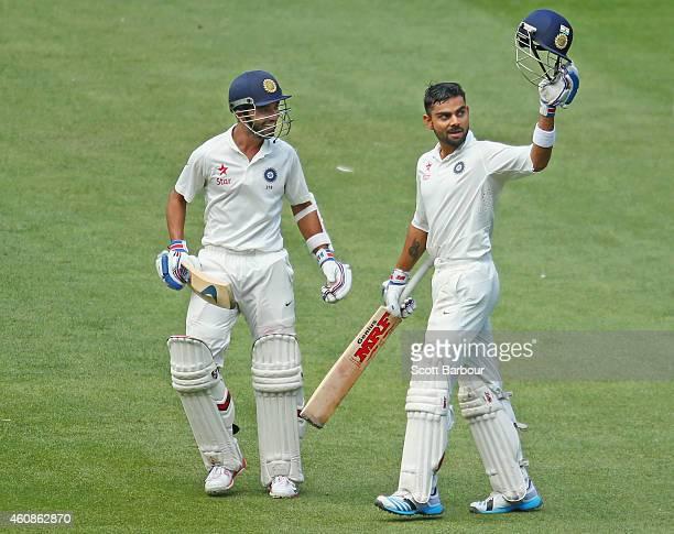 Virat Kohli of India celebrates after reaching his century as Ajinkya Rahane looks on during day three of the Third Test match between Australia and...