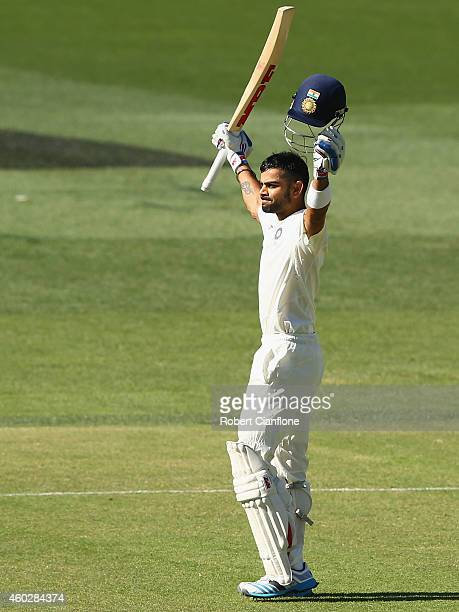 Virat Kohli of India celebrates after reaching his century during day three of the First Test match between Australia and India at Adelaide Oval on...