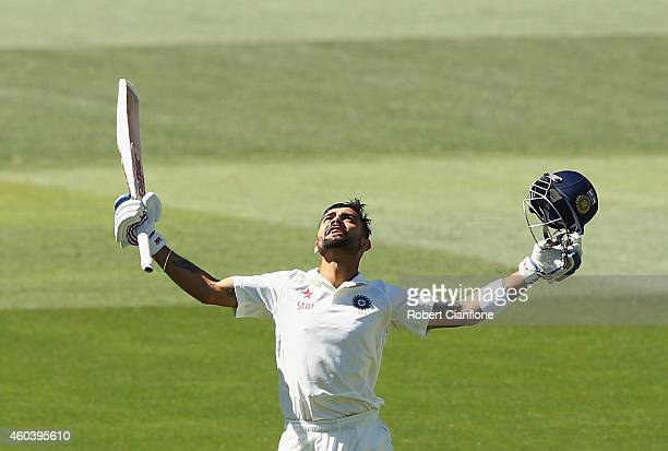 Virat Kohli of India celebrates after reaching his century during day five of the First Test match between Australia and India at Adelaide Oval on...