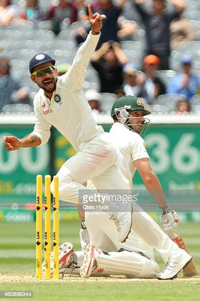 Virat Kohli of India celebrates after running out Shaun Marsh of Australia on 99 runs during day five of the Third Test match between Australia and...