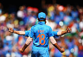 Virat Kohli of India celebrates after taking a catch to dismiss David Warner of Australia off the bowling of Umesh Yadav of India during the 2015...