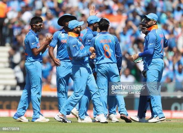 Virat Kohli of India celebrates after they take the wicket of AB de Villiers of South Africa during the ICC Champions Trophy Group B match between...