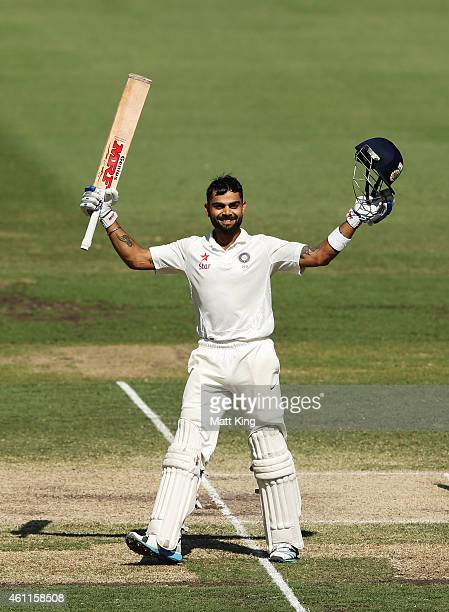 Virat Kohli of India celebrates and acknowledges the crowd after scoring a century during day three of the Fourth Test match between Australia and...